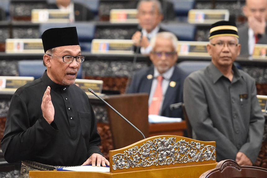 Malaysian politician Anwar Ibrahim takes an oath as a member of the parliament during the swearing-in ceremony at Parliament House in Kuala Lumpur on Oct 15, 2018.