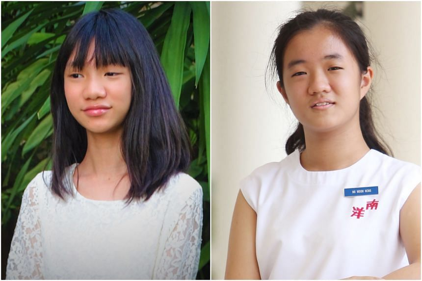 Janine Shum (left) wrote a poem from the perspectives of an Afghan girl and a Singaporean girl, while Ng Woon Neng crafted a short story on her view of wealth, health, freedom and happiness. They were among four winners selected out of 12,000 partici