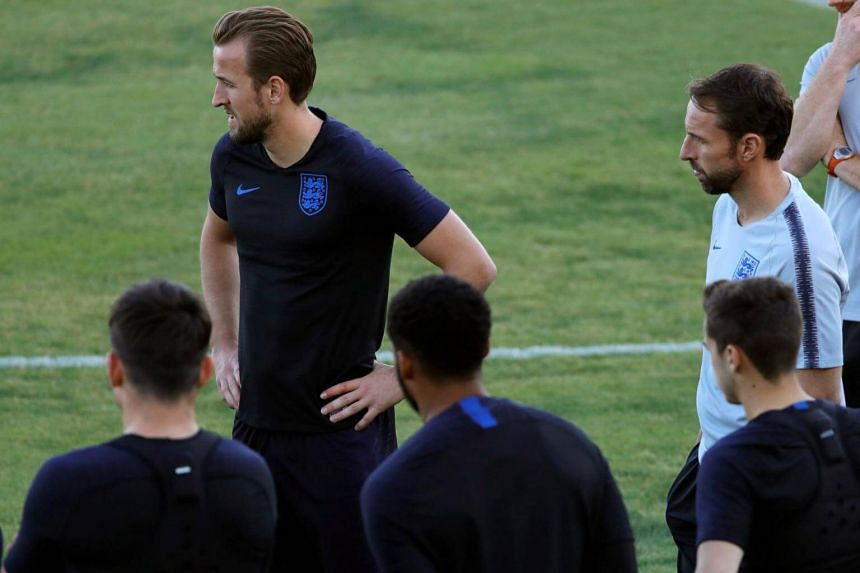 England's national soccer team head coach Gareth Southgate (right) and forward Harry Kane attend a training session in Seville, Spain, on Oct 14, 2018.