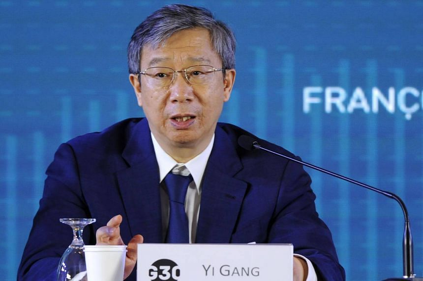 Governor People Bank of China Yi Gang speaks at the International Monetary Fund and World Bank annual meetings in Nusa Dua, Bali, on Oct 14, 2018.