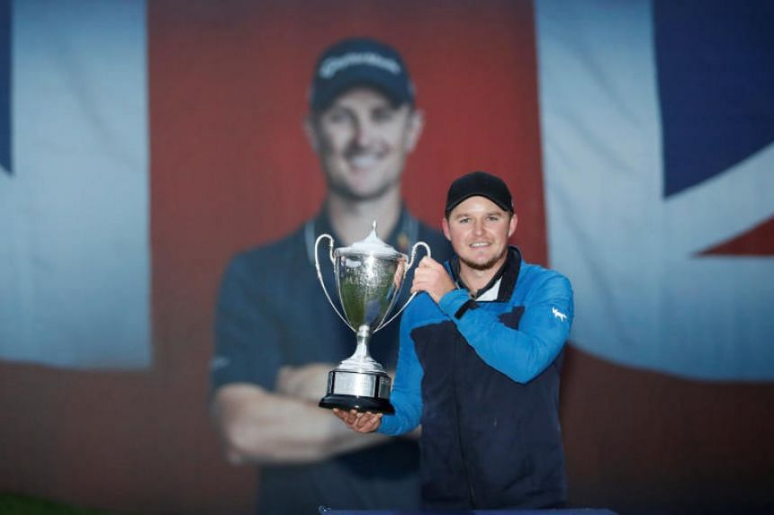 England's Eddie Pepperell celebrates winning the British Masters at Walton Heath Golf Club, Walton-on-the-Hill, Britain, on Oct 14, 2018.
