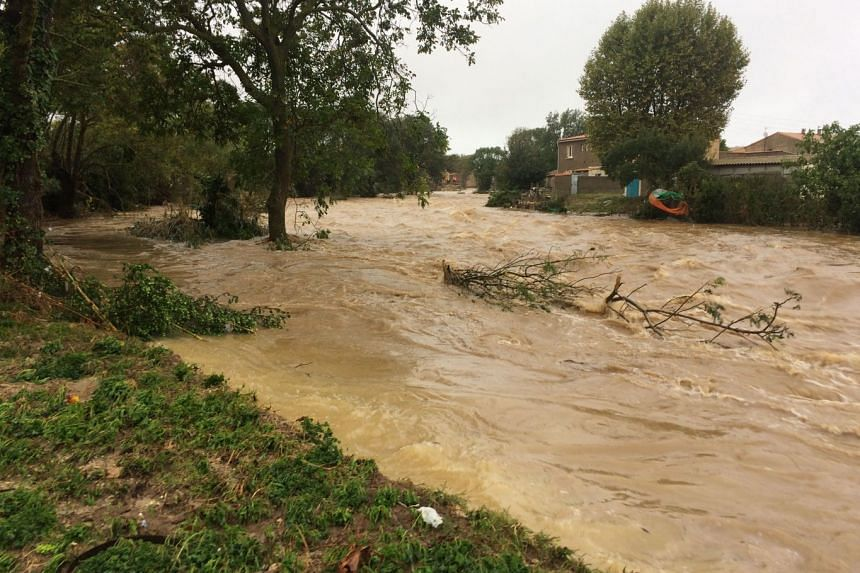 The Trapel river burst its banks following heavy rains, in Villegailhenc, near Carcassone, southern France, on Oct 15, 2018.