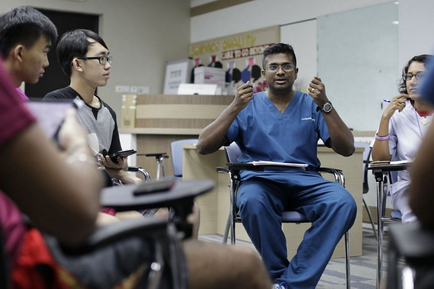 Not even the earth itself could stop Dr Kumaran Rasappan (centre) from rendering medical assistance in the aftermath of the April 2015 earthquake. PHOTO: GIN TAY