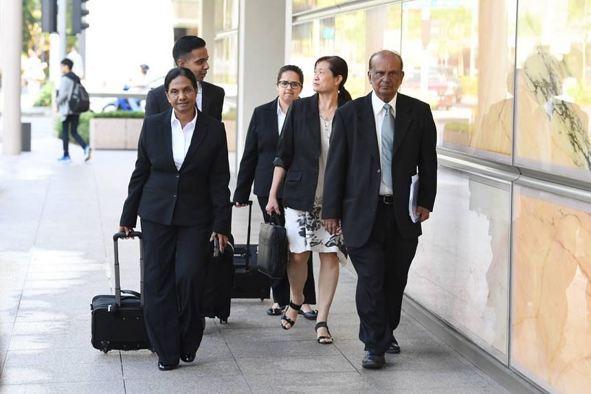 Ms How Weng Fan (second from right) arriving at the Supreme Court on Oct 15 with her lawyer Leslie Netto (right) and legal team.