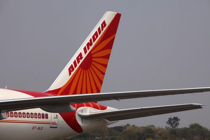 The cabin crew member fell off while closing the back door of the Boeing 777.