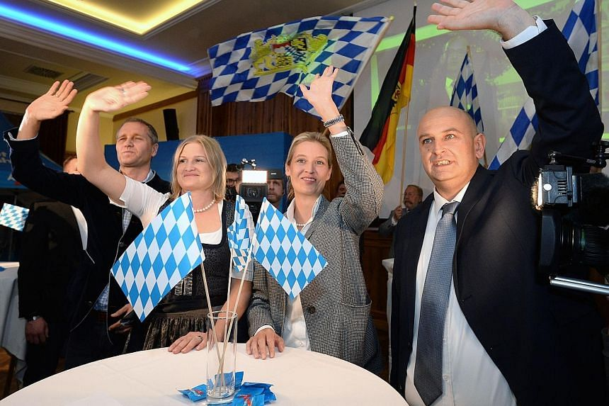 Green Party candidates Ludwig Hartmann and Katharina Schulze celebrating on Sunday, as the party became Bavaria's second-strongest, drawing support especially in big cities like Munich.