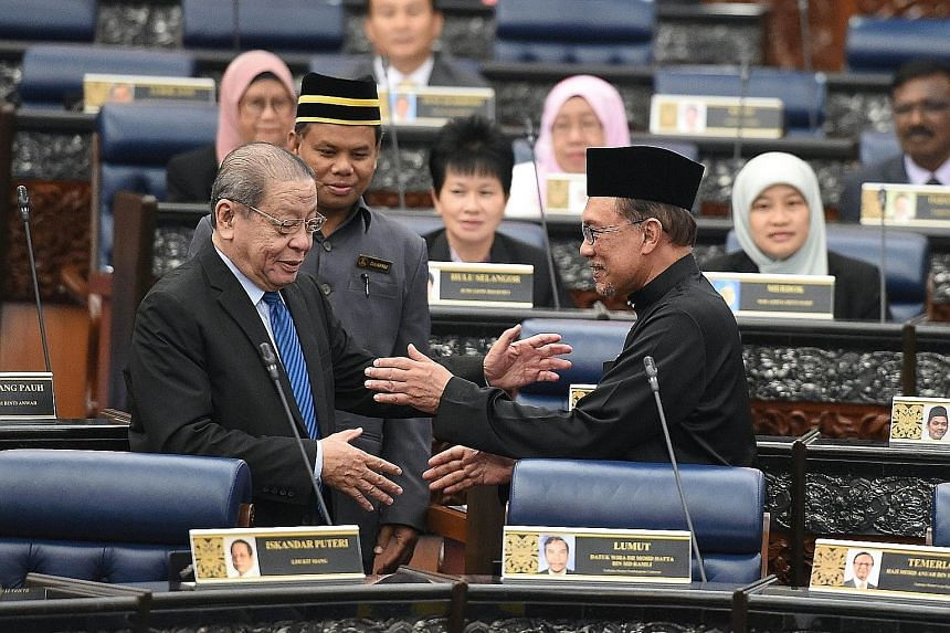 Malaysia's Deputy Prime Minister Wan Azizah Wan Ismail and Prime Minister Mahathir Mohamad in Parliament yesterday. First up on PH's agenda is Thursday's midterm review of the 11th Malaysia Plan, a five-year economic blueprint. Datuk Seri Anwar Ibrah