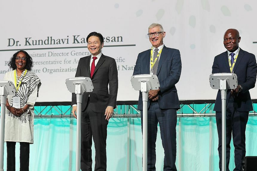 (From left) United Nations' Food and Agriculture Organisation assistant director-general Kundhavi Kadiresan, Minister for National Development Lawrence Wong, International Rice Research Institute director-general Matthew Morell and International Fund
