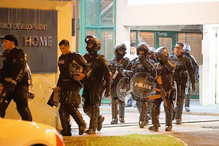 Police officers in riot gear leaving the Singapore Boys' Home in Jurong West Street 24 on Sept 28, after bringing the riot on the premises under control within two hours.