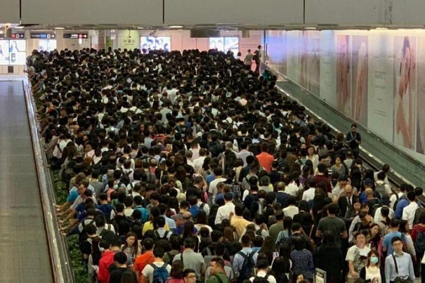 Commuters affected by the glitch on Oct 16, 2018. The network's Island, Kwun Tong and Tsuen Wan lines were operating at slower speeds due to the glitch, extending total journey time by 40 minutes, MTR Corp said on its website.
