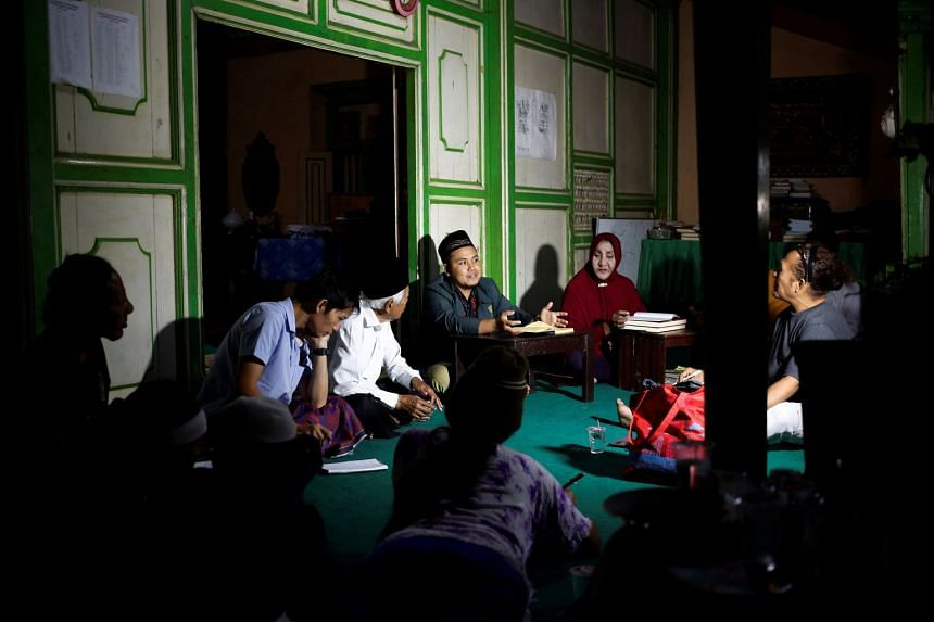 A group of transgender women listen to cleric Arif Nuh Safri (centre) as he leads a Quran study session in Yogyakarta, Indonesia, on Sept 23, 2018.