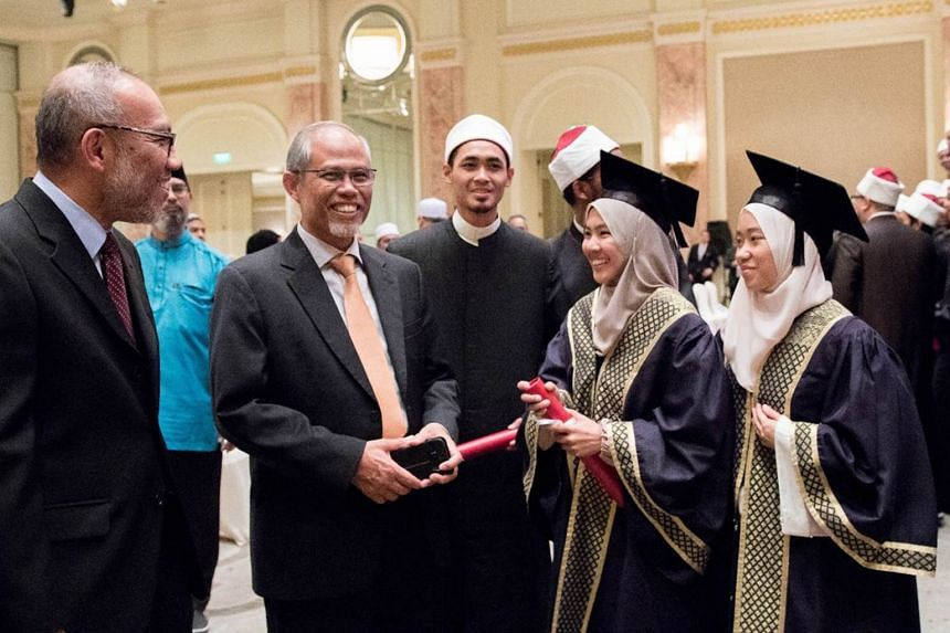 Minister-in-charge of Muslim Affairs Masagos Zulkifli (second from left) pressed the importance of having a zeal for continuous learning, in order for graduates to stay relevant as religious teachers.