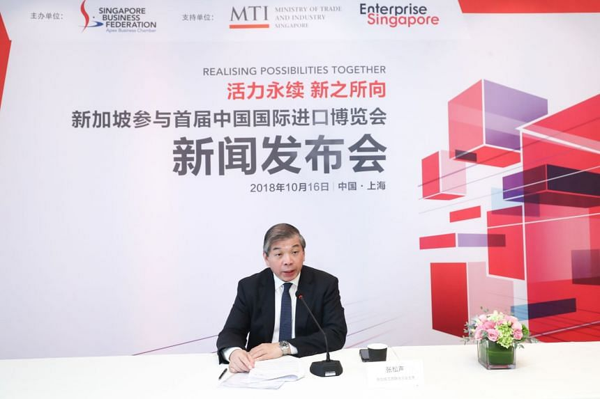 Singapore Business Federation chairman Teo Siong Seng speaking at a press briefing in Shanghai on Oct 16, 2018, on Singapore companies' participation at the inaugural China International Import Expo.