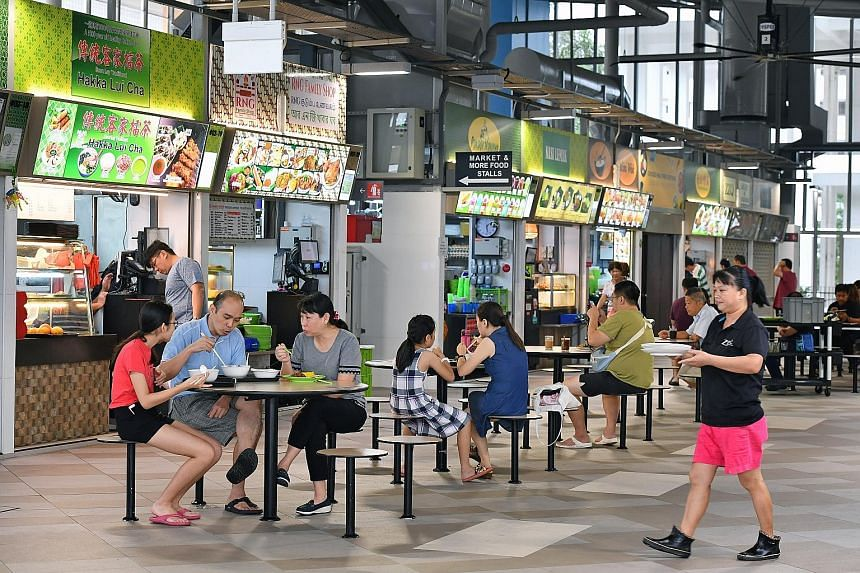 Jurong West Hawker Centre tenants are charged 20 cents for every tray issued to them. Twelve tenants have signed a petition to remove the fee. Some of them met the operator yesterday to discuss possible options.