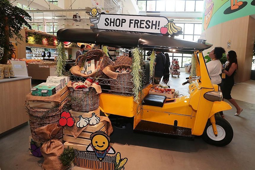 Customers buying 10 or fewer items at the supermarket can use their smartphone to scan each item and pay using the Honestbee app. There will be more than 20,000 products, including fresh produce, seafood and meat on sale when the new Habitat by Hones