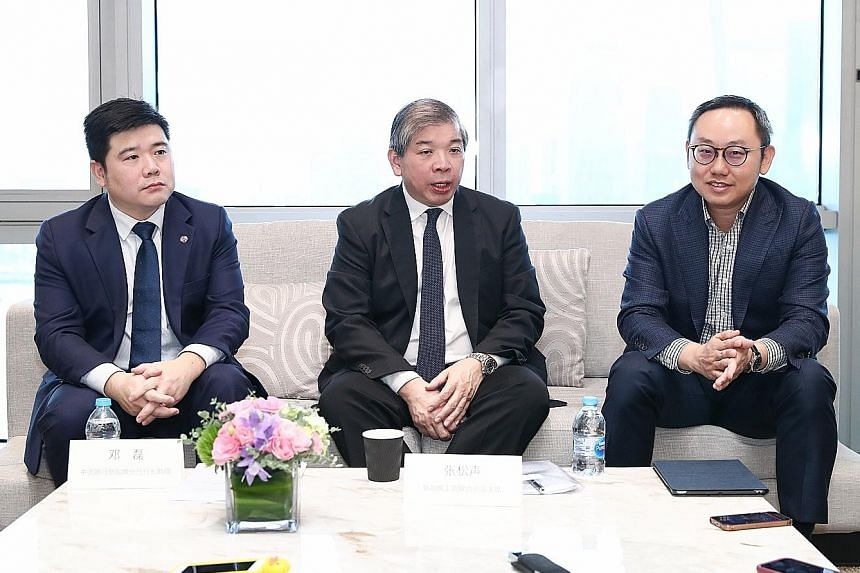(From left) Mr Deng Lei, assistant general manager of Bank of China Singapore branch; Singapore Business Federation chairman Teo Siong Seng; and Mr Ho Chee Hin, global markets executive director, China group, Enterprise Singapore, at a briefing yeste