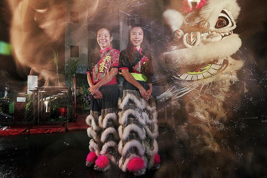 Bank officer Stella Chua (left) and visual merchandiser Leow Hui Zhi are among a small but growing number of women competing in lion dance championships.