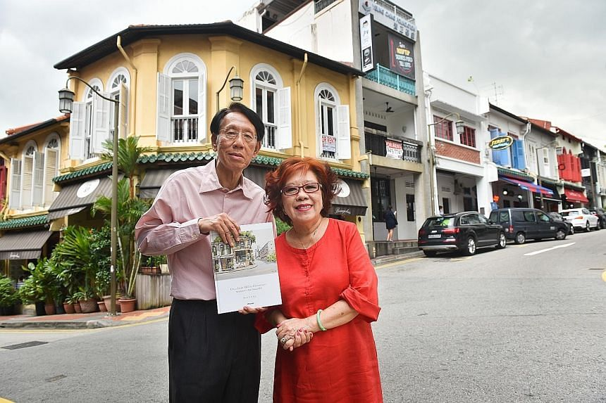 Mr Yap Boh Tiong with the book he initiated, On A Little Hill In Chinatown: Singapore's Ann Siang Hill. With him is Ms Wong Kok Yee, managing director of Tin Sing Goldsmiths. They are standing in front of the building in Club Street that inspired the