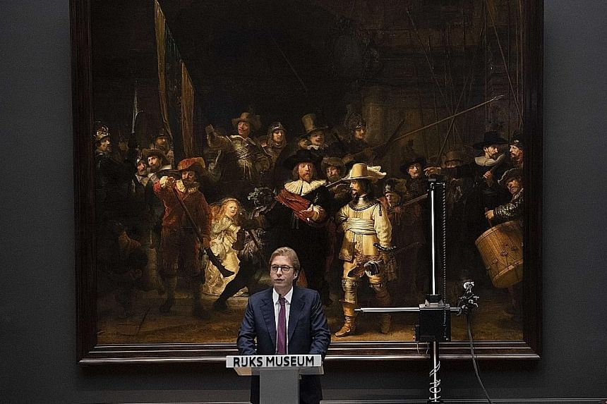 Rijksmuseum general director Taco Dibbits speaking in front of Rembrandt's The Night Watch on Tuesday.