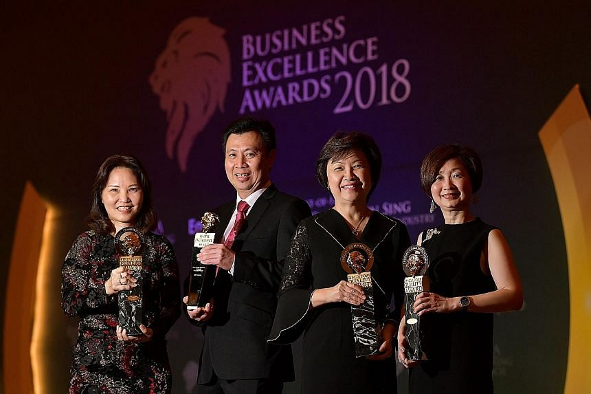 Receiving Business Excellence Awards yesterday on behalf of their organisations were (from far left) Institute of Technical Education CEO Low Khah Gek, Beca Carter Hollings & Ferner (South-east Asia) managing director Lee Ang Seng, Housing Board CEO