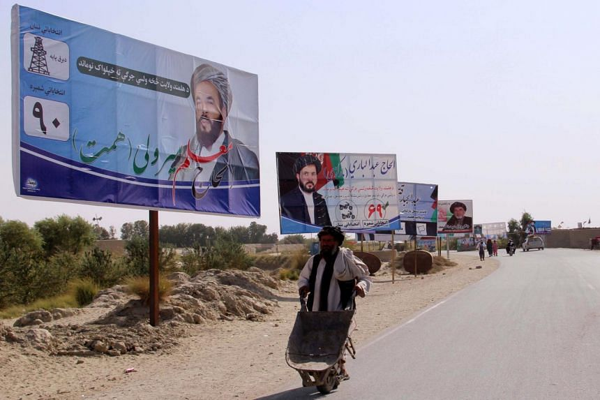 Electoral billboards for the candidates of upcoming Wolesi Jirga (Lower House of the Parliament) elections are installed on a road side, in Helmand, Afghanistan, on Oct 15, 2018.