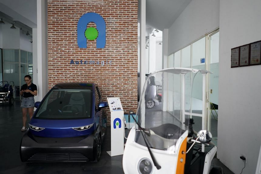 Electric cars are seen in a workshop of Automagic in Hangzhou, Zhejiang province, China, on Sept 26, 2018.