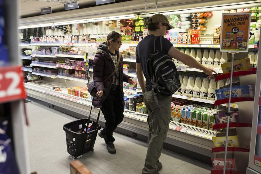 Mrs Nevine Mann and her husband Richard shop for supplies at a local store in Cornwall, England, on Oct 14, 2018.