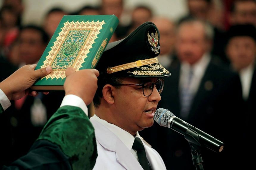 Jakarta Governor Anies Baswedan stands during a swearing-in ceremony at the Presidential Palace in Jakarta, Indonesia, on Oct 16, 2017.