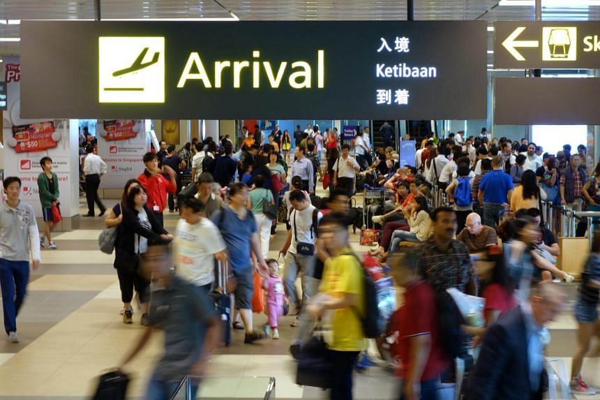 File photo showing travellers and tourists at the arrival hall of Changi Airport Terminal 1.
