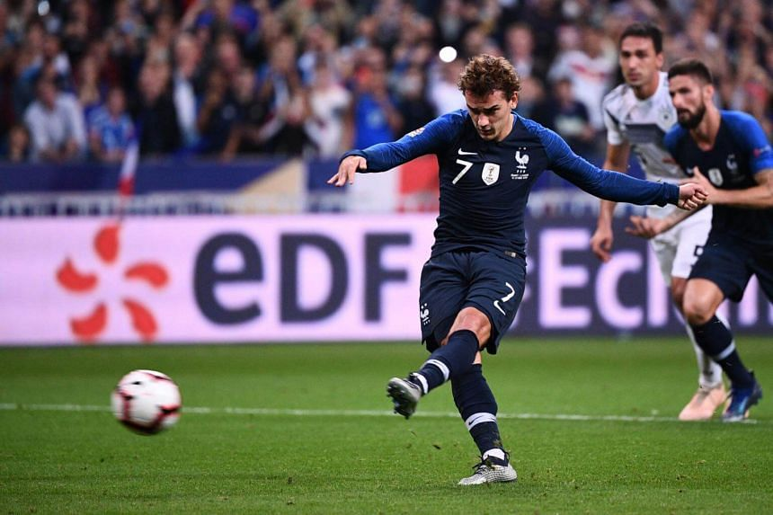 France's forward Antoine Griezmann kicks to score their second goal during the match between France and Germany at the Stade de France in Saint-Denis, near Paris, on Oct 16, 2018.