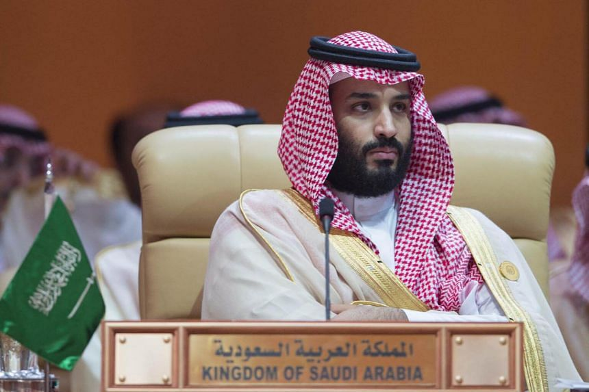 One suspect has been photographed emerging from planes with Crown Prince Mohammed bin Salman (above) on recent trips to Madrid and Paris.