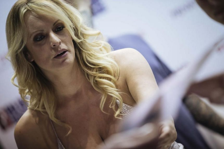 Former adult actress Stephanie Clifford, known as Stormy Danielsm signs autographs during the Venus Erotic Trade Fair in Berlin, Germany, on Oct 12, 2018.