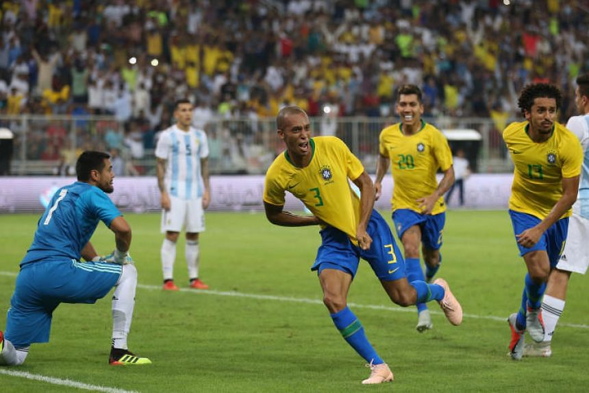 Brazil's defender Miranda (second from left) celebrates after scoring a goal during the friendly football match between Brazil and Argentina at the King Abdullah Sport City Stadium in Jeddah, on Oct 16, 2018.