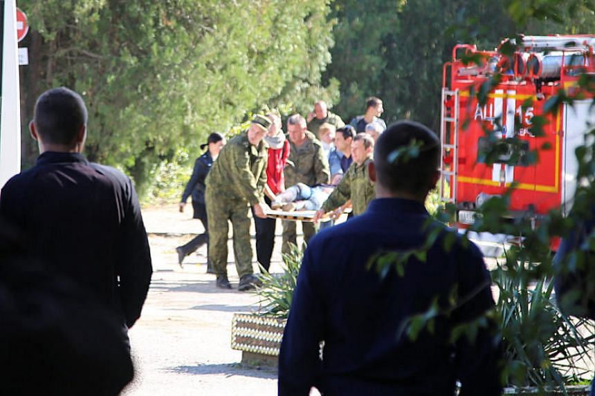 Emergency services help injured people after a fatal attack on a college in the port city of Kerch, Crimea, on Oct 17, 2018.