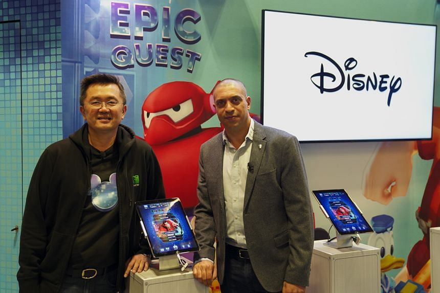 Mr David Ng (left), founder and chief executive officer of goGame, and Mr Dan Dossa, Walt Disney South Asia's vice-president and general manager of consumer products commercialisation, announcing the collaboration last week.