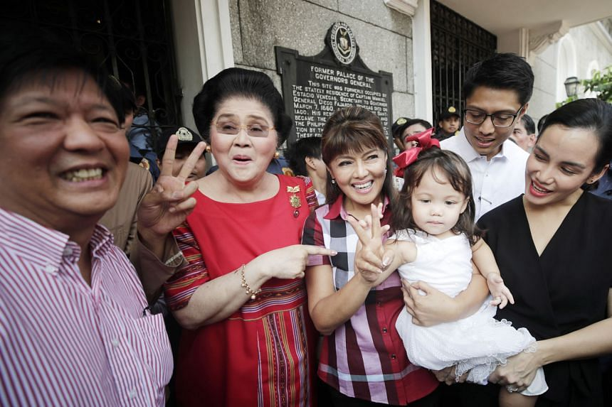 Mrs Imelda Marcos, 89, former Philippine dictator Ferdinard Marcos' widow, pointing to her daughter Imee after the younger Marcos filed her certificate of candidacy yesterday to run in the Senate elections next year. The Marcos family has capitalised