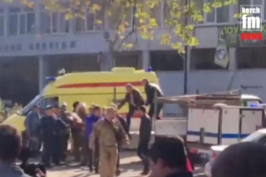 Screengrab from a video showing emergency services carrying an injured victim of a blast at at a college in Kerch, Crimea, on Oct 17, 2018.