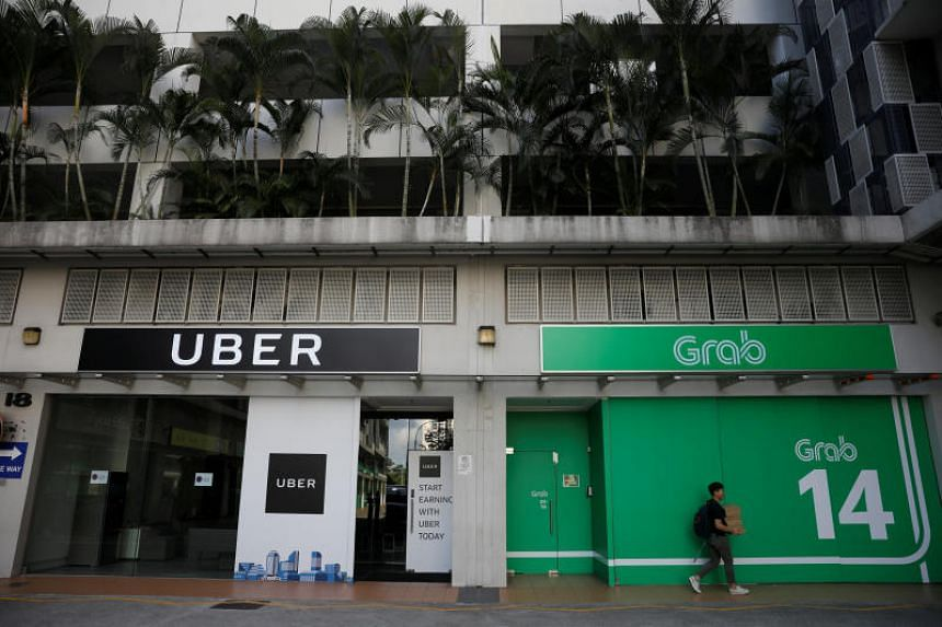 File photo of the Uber and Grab offices in Singapore. Uber sold its South-east Asian business to bigger regional rival Grab in March earlier this year, prompting regulatory scrutiny across the region.