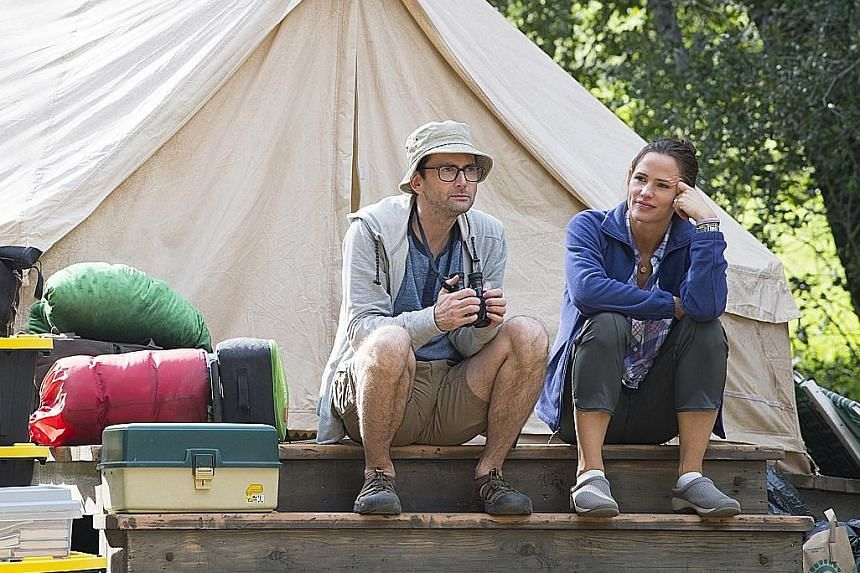 In Camping, Jennifer Garner plays the domineering Kathryn, while David Tennant (both left) plays her husband.