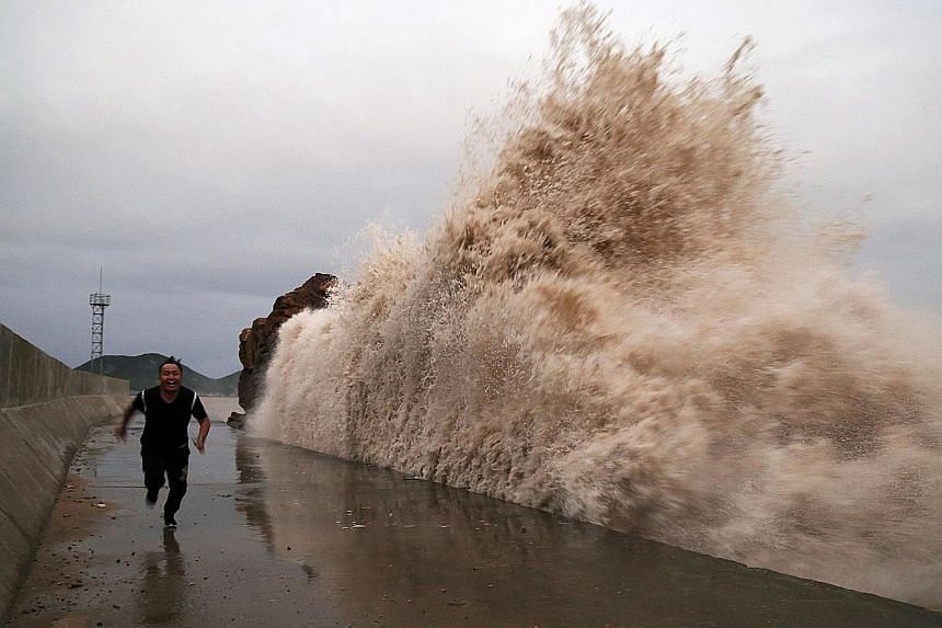 Huge waves brought by an approaching typhoon in Taizhou in China's Zhejiang province earlier this month. Based on current trends of global warming, more intense extremes of heat, rainfall and storms are on the rise. More can be done to reduce these c