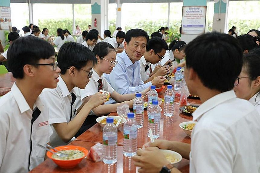 Some students from Northland Secondary School having a meal with Education Minister Ong Ye Kung yesterday in their school canteen. In a Facebook post yesterday, Mr Ong said he encouraged the students to focus on learning, amid recent changes to reduc