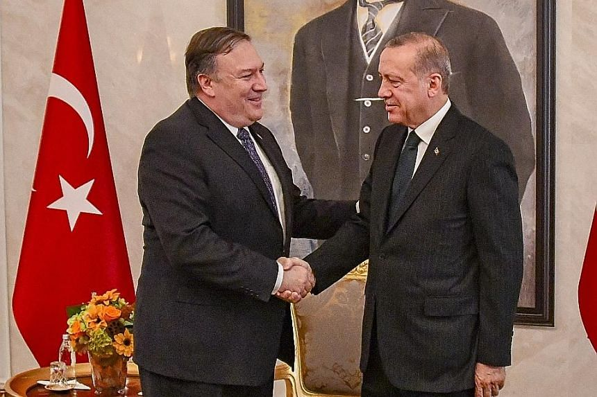 US Secretary of State Mike Pompeo (far left) with Turkish President Recep Tayyip Erdogan at their meeting in Ankara yesterday. The top diplomat arrived in Ankara after Riyadh, where he met King Salman and later, his son Prince Mohammed.