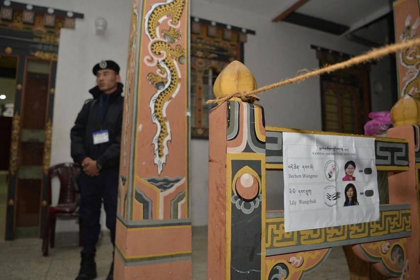 A Bhutanese police personnel stands near the main entrance of a polling booth in Thimpu, on Oct 17, 2018.