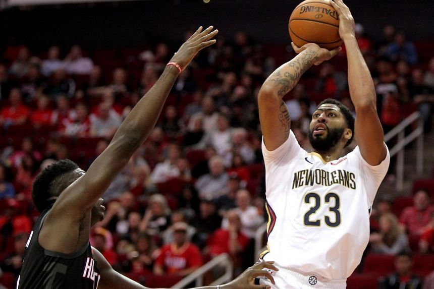New Orleans Pelicans' Anthony Davis attempts a jump shot against the Houston Rockets during their NBA match at Toyota Center in Houston, Texas, on Oct 17, 2018.
