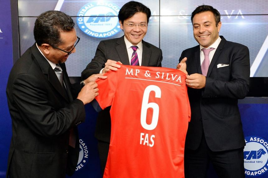 Then Football Association of Singapore (FAS) president Zainudin Nordin (left), then Minister of Culture, Community and Youth Lawrence Wong (centre) and MP & Silva's founding partner Andrea Radrizzani during the signing of a six-year deal with the FAS