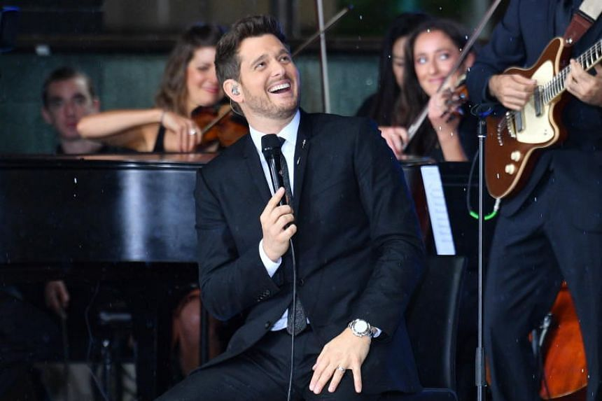 Michael Buble (centre) performs for a television programme at Martin Place, Sydney, Australia, on Oct 4, 2018.