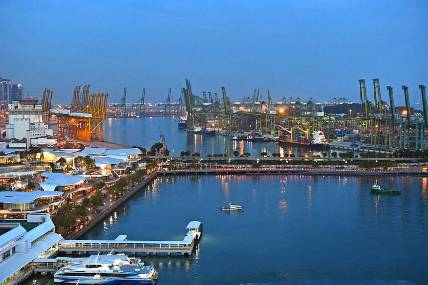 VivoCity (left) on mainland Singapore with the bridge leading to Sentosa, and Pulau Brani in the background. The relocation of port terminals to Tuas will free up some 1,000ha of land for a new waterfront city.