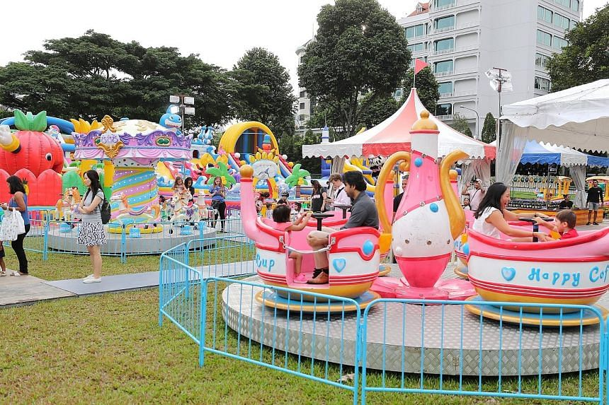 Kicking off the festival is the Lah Bazaar, offering street food such as Ramly burgers, as well as children's rides (above). To be in line with Singapore's drive to go cashless, the main mode of payment will be ez-link cards, which can be purchased a