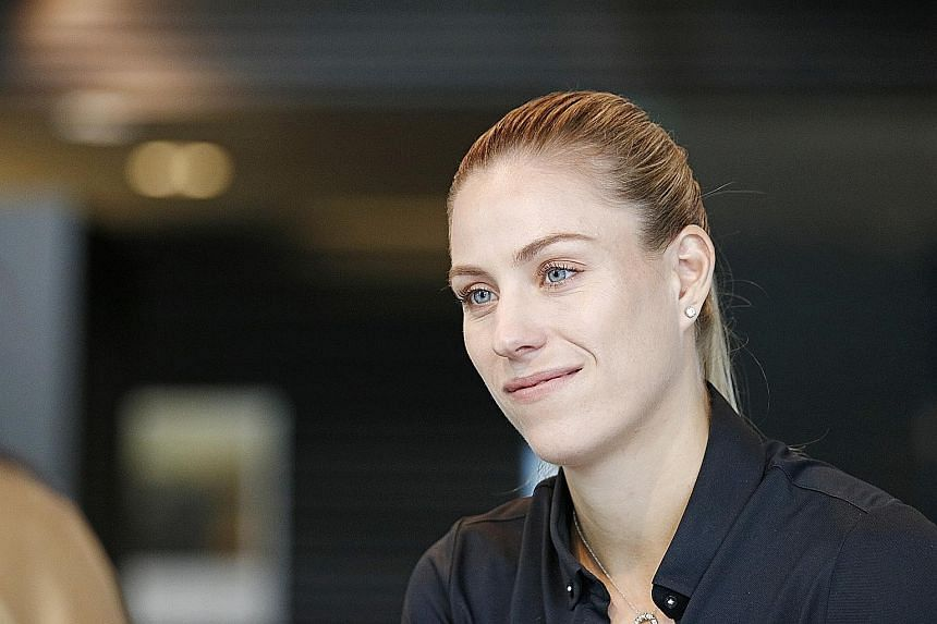 Clad in black with her hair pulled back in a ponytail and fingernails painted bright red, Angelique Kerber was a picture of poise at the Porsche Centre Singapore yesterday. The runner-up at the 2016 WTA Finals Singapore is an ambassador for the Germa
