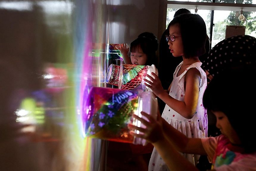 An artist's impression of The Rainbow Connection by Singaporean industrial designer Lee Yun Qin. It will feature hundreds of upcycled plastic polyethylene terephthalate containers with solar light modules suspended in the air. Children with PET conta